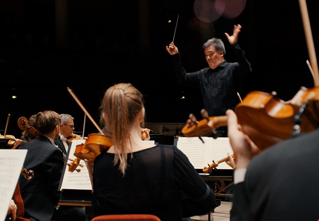 Conductor in front of an orchestra. Picture from video