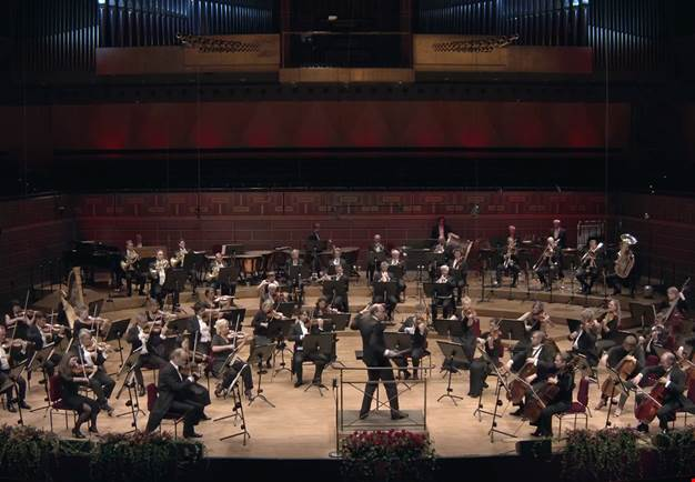 Large orchestra playing. From the concert.