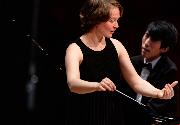 Conductor and pianist during a concert. Photo.