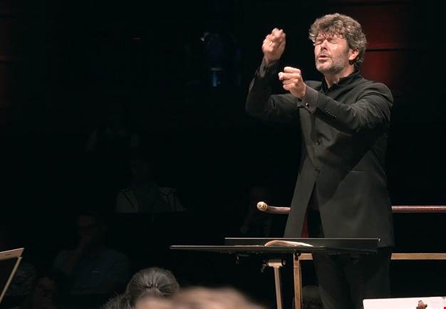 Man conducting with intense. From the concert.