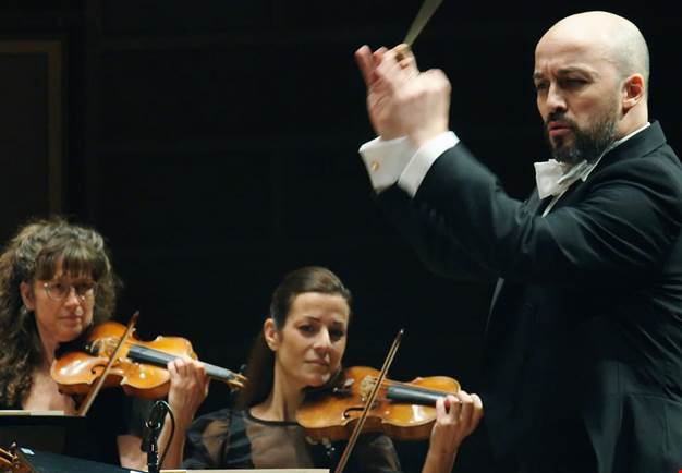 A serious man conducting. From the concert.