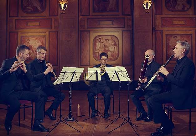 Four people playing chamber music. From the concert.