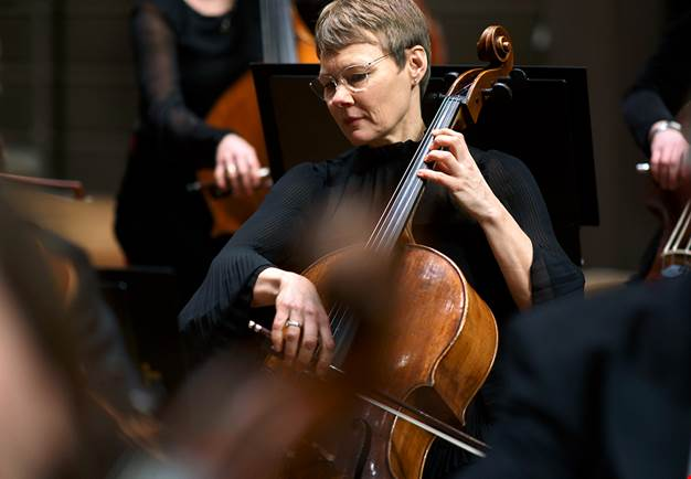 Woman playing cello. Photo.