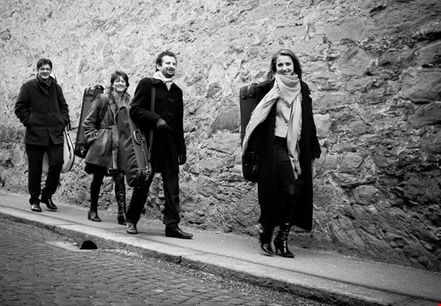 Group picture of the quartet walking outside. Black and white Photography.