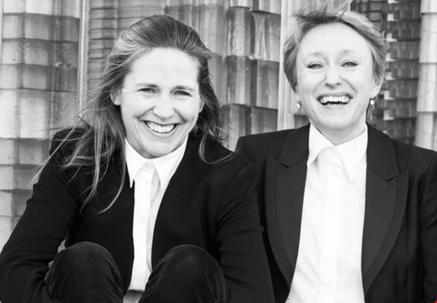 Portrait of two women and laughing. Black and white photo.
