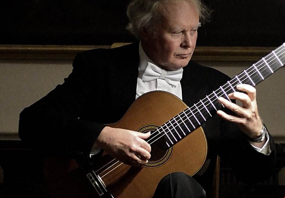 Man playing classical guitar. Photo.