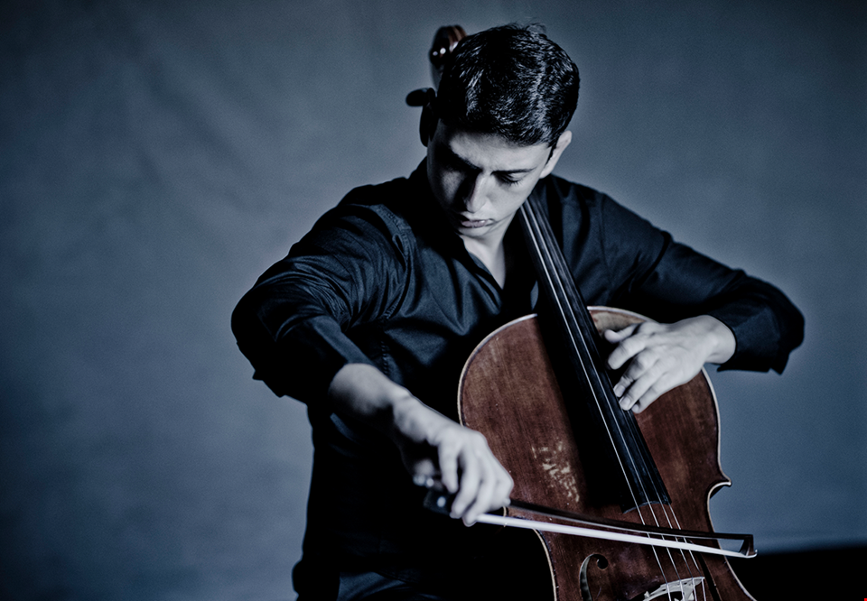 Young man playing cello. Photo.