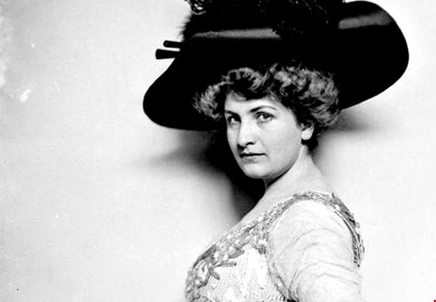 Woman with a large hat. Black and white photo.